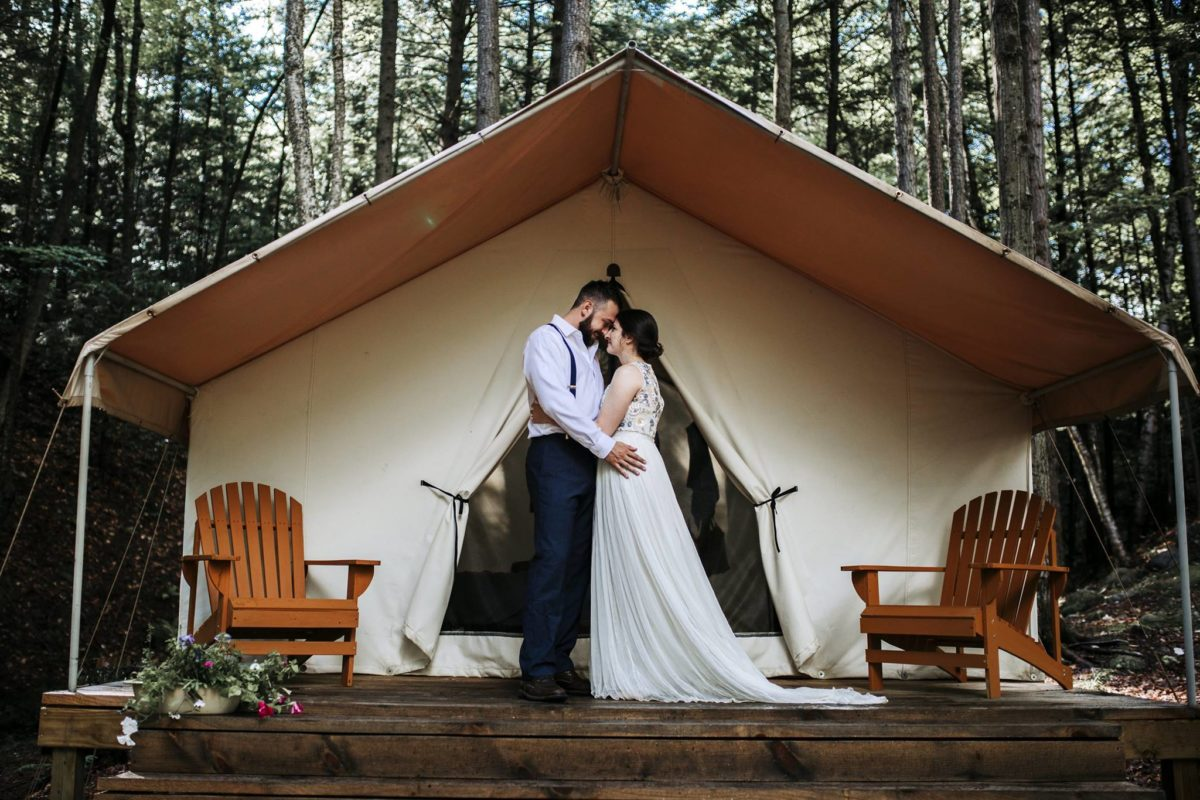 Couple in front of a tent