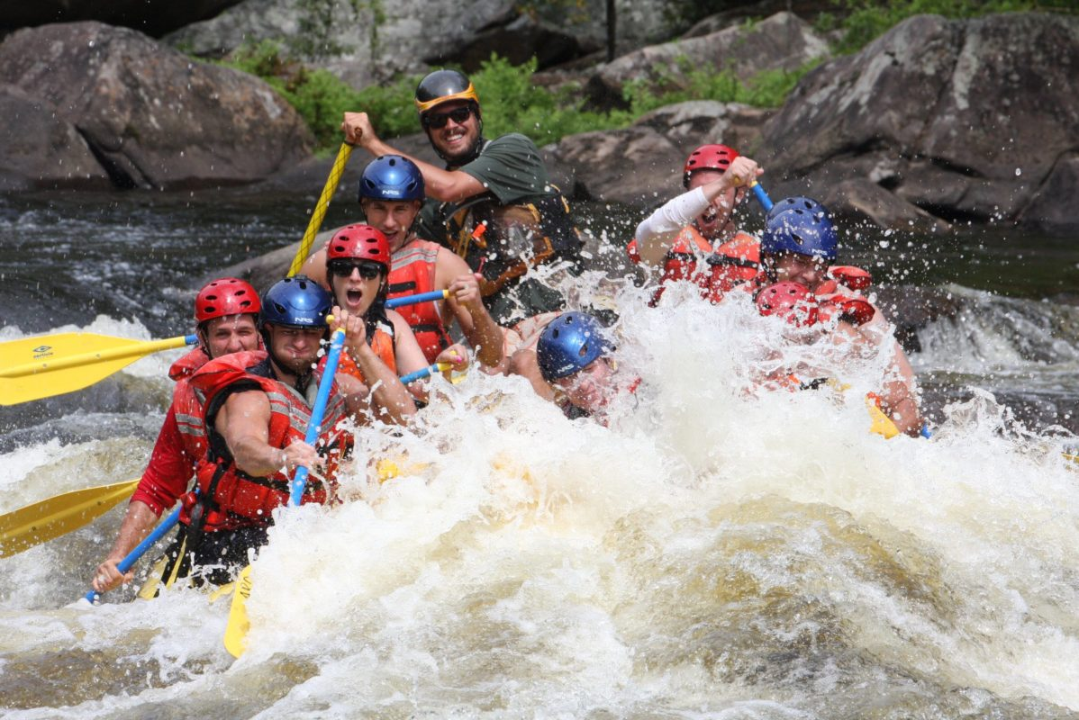 People whitewater rafting in the Adirondacks
