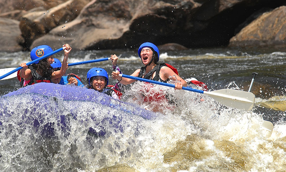 Joyus person white water rafting