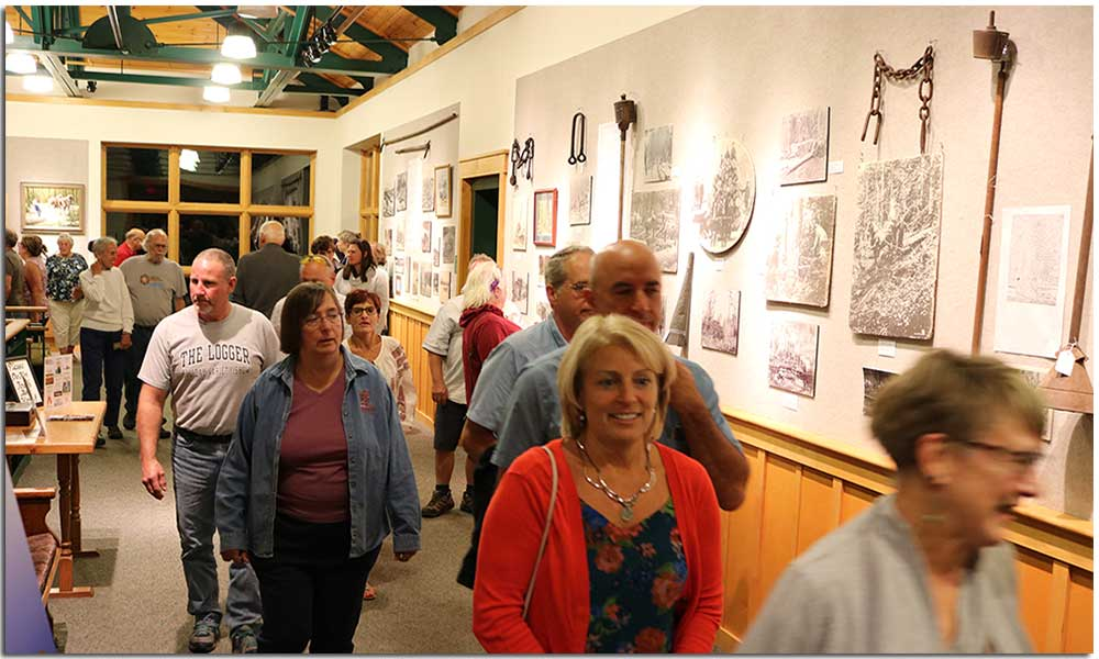 Patrons within the Tannery Pond Community Center gallery in the Town of Johnsburg, NY