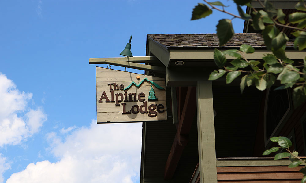 Sign for The Alpine Lodge