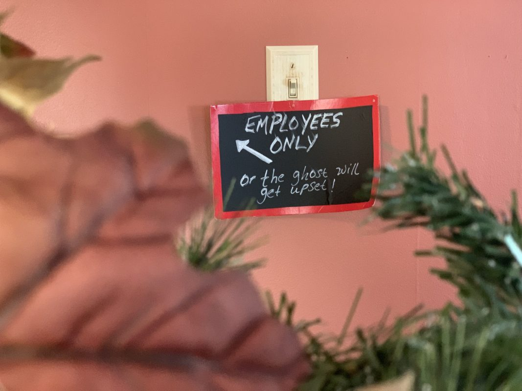 Light switch with a sign saying Employees Only at Barkeater Chocolate