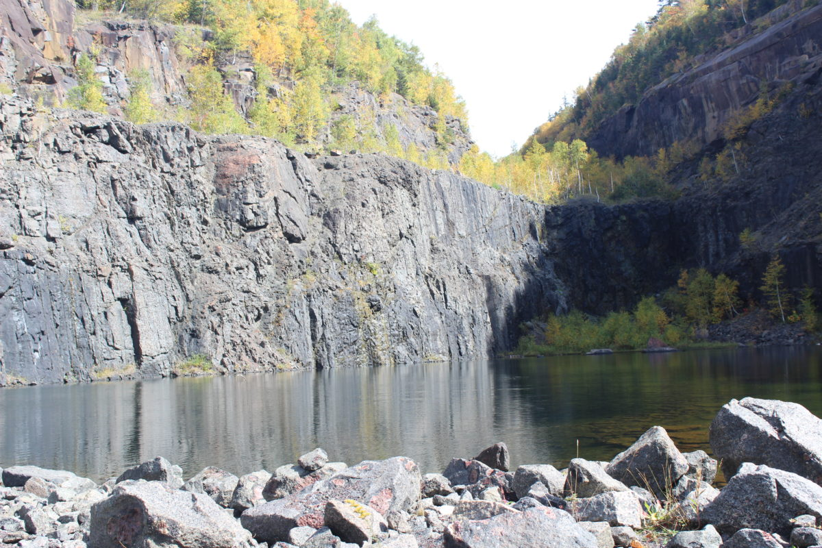 The scenic Barton Garnet Mine with steep cliffs and water